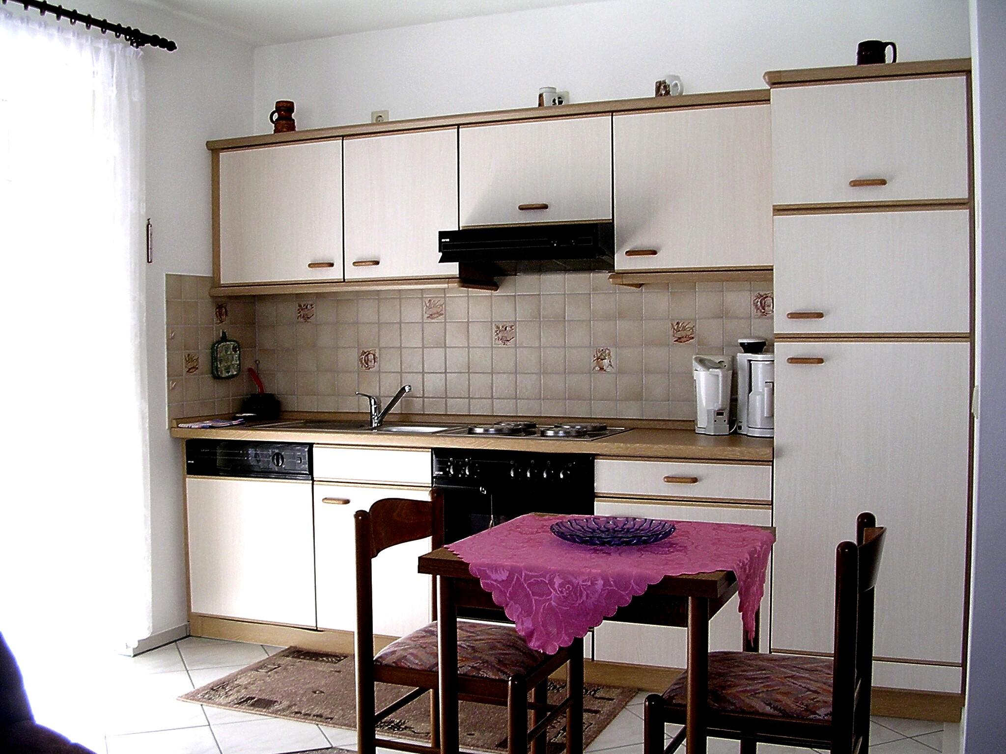 k che pink mischarmatur k che wanduhr modern wasserhahn frau sch ner wohnen outdoor kleine mit. Black Bedroom Furniture Sets. Home Design Ideas